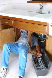 Surprise AZ plumbing technician repairs garbage disposal